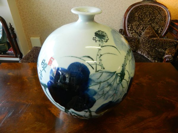 white porcelain vase with water lily home decoration