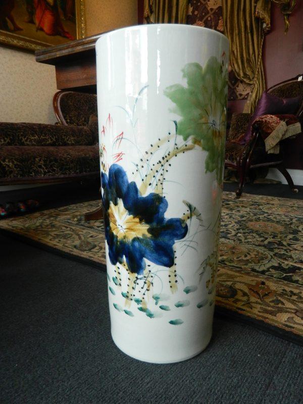 blue floral design white long vase