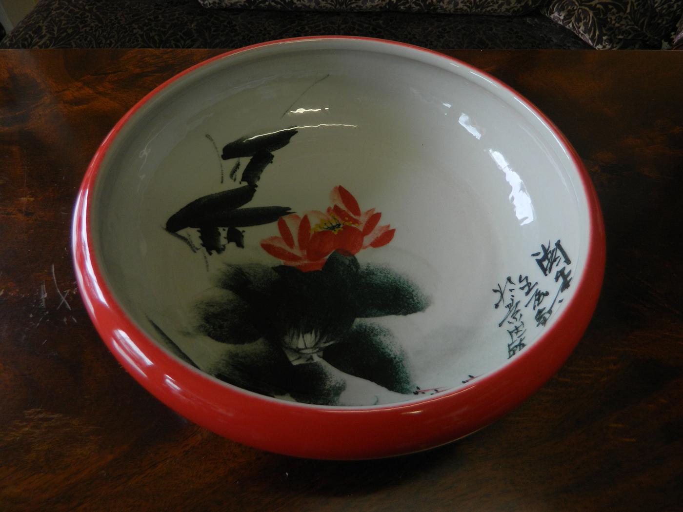 red handmade porcelain bowl