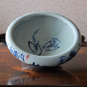 Handmade Porcelain Bowl with Free Hand Painted Blue Water Lily Outside
